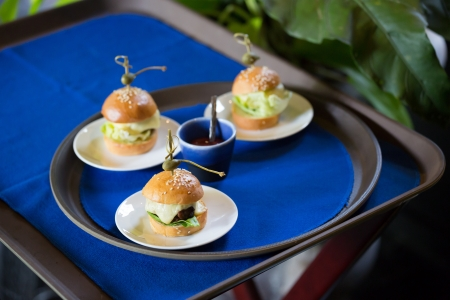 Delicious mini burger canapes on a white plate Stock Photo