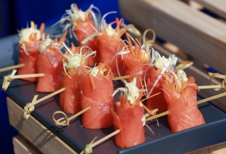 Colorful salmon canapes on a blue tray photo
