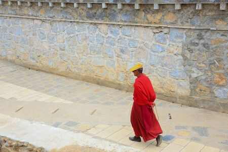 Tibetan monk walking in Songzanlin Monastery in Zhongdian (Shangri-La), Yunnan, China
