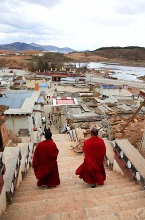 Tibetan monks walking in Songzanlin Monastery in Zhongdian (Shangri-La), Yunnan, China
