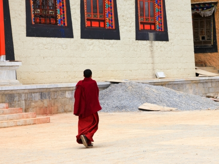 dalai: Tibetan monk walking in Songzanlin Monastery in Zhongdian (Shangri-La), Yunnan, China