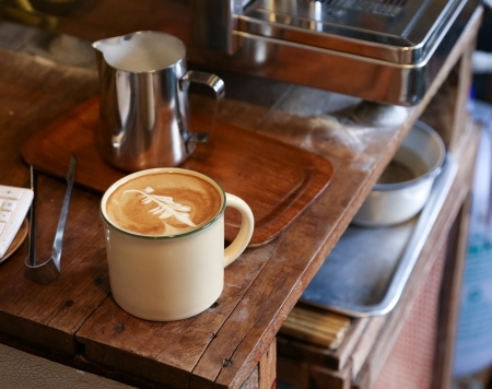 Beautiful coffee art in an enamel mug Stock Photo - 18757929