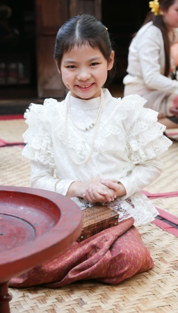 Little thai girl in a traditional costume Stock Photo