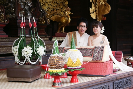 Bride and Groom in traditional thai northen style wedding ceremony Stock Photo