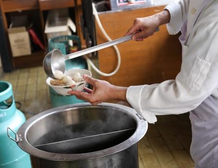 thai noodle soup: A chef is preparing meat ball noodle soup