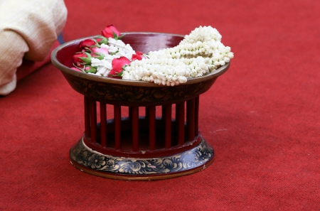 Thai jasmin wedding garland in a wedding ceremony photo