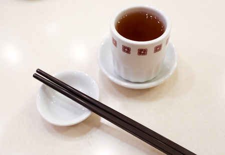 Chinese tea with a pair of chopsticks Stock Photo - 19281731