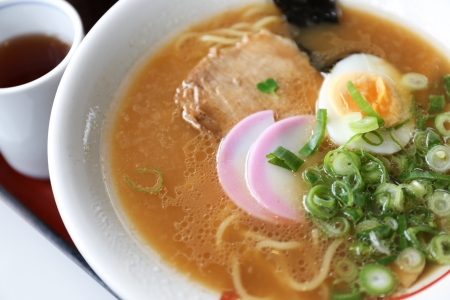Close-up japanese noodle called ramen in a white bowl photo