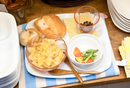 Macaroni and bread set  in white plate photo