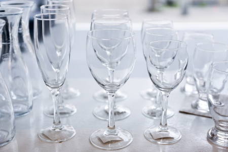 Group of empty crystal clear glasses and bottles Stock Photo