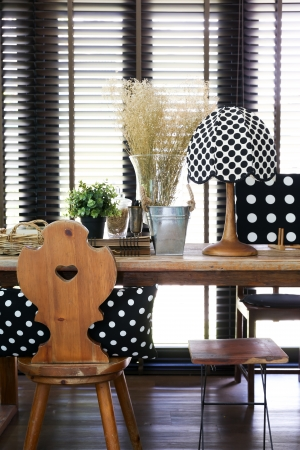Wooden table and chair with a vintage polka dot lamp