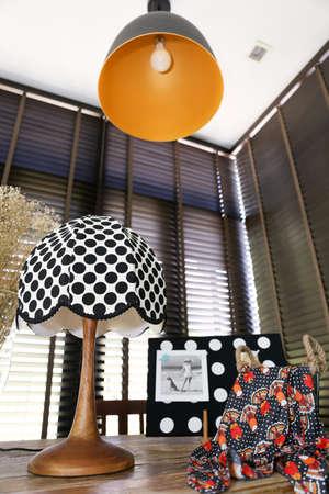 Polka dot vintage lamp and a colorful shawl photo