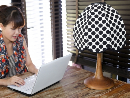 Vintage polka dot lamp with intentionally out of focus working woman in background photo