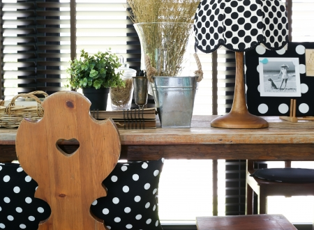 classic furniture: Wooden table and chair with a vintage polka dot lamp