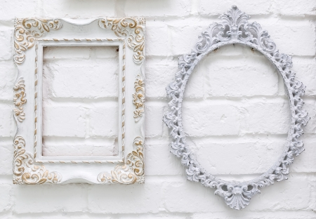Vintage picture frames on white brick wall background photo
