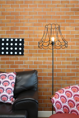 Vintage lamp with a colorful chair and sofa
