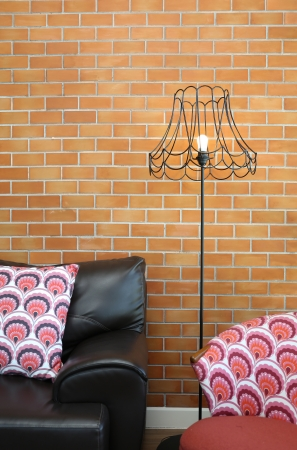 Vintage lamp with a colorful chair and sofa photo