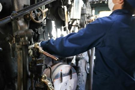 Stream train worker inside the cockpit Stock Photo - 20754140