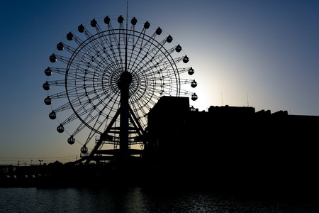 Silhouetted giant wheel in Shimizu, Japan Stock Photo