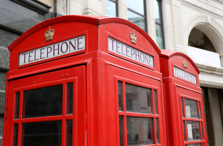 Classic red telephone booth in London, England, UK photo