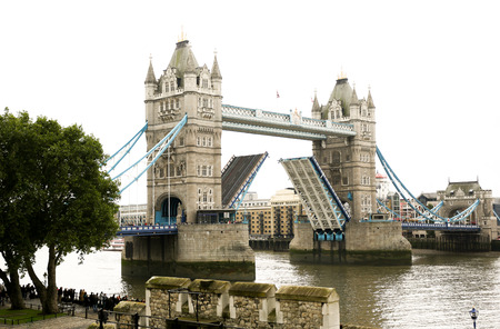 Opening London Tower Bridge in the middle of Thames River in London, England, UK