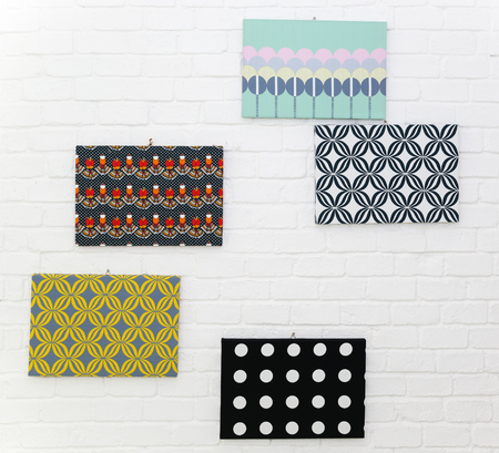 Wall decoration with pattern cardboard on white brick wall background Archivio Fotografico