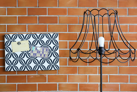 Magnet memo on pattern cardboard with vintage lamp and brick wall background