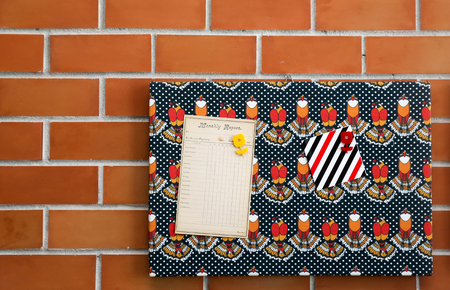 Vintage monthly report memo on pattern cardboard with brick wall background Archivio Fotografico