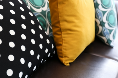 Colorful pillows on leather sofa