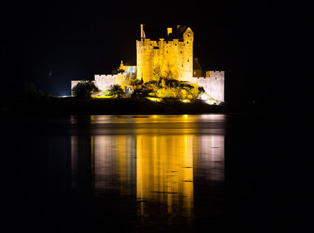 Eilean Donan Castle at night in Scotland, UK