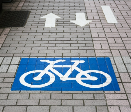 Bicycle lane sign in a city area