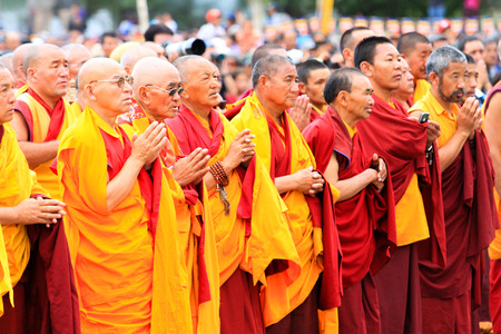 LEH, INDIA - AUGUST 5, 2012: Unidentified buddhist monks and lamas attend His Holiness the 14th Dalai Lama teaching on August 5, 2012 at Shewatsel Grounds, Leh, Jammu and Kashmir, India.