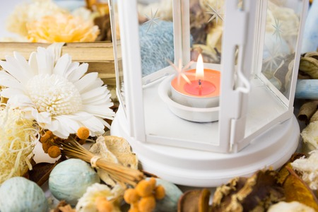 Dried flowers with lamp and candle for scented perfume aroma therapy