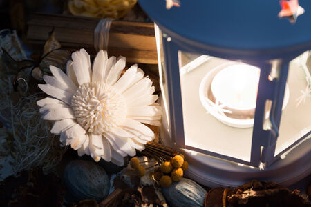 Dried flowers and lamp with burning candle in the dark Archivio Fotografico