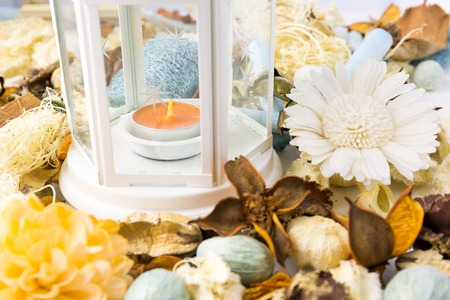 Dried flowers with lamp and candle for scented perfume aroma therapy photo