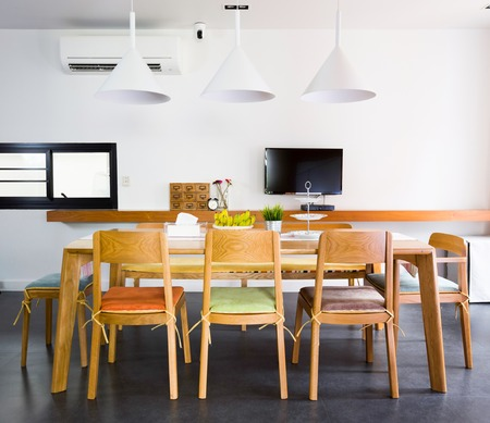 Contemporary dinning room with wooden tables and chars