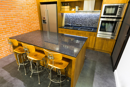 pantry: Stylish modern contemporary kitchen with island bar, chair and home appliances
