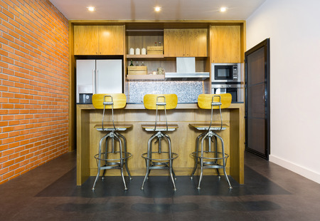 bar stool chair: Stylish modern contemporary kitchen with island bar, chair and home appliances