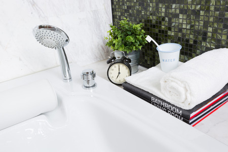 Modern style luxurious bathtub with alarm clock in early morning