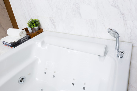 Modern style luxurious bathtub with white marble wall