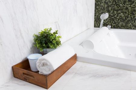 bathroom design: Modern style luxurious bathtub with white marble wall