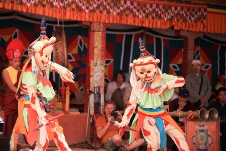 LADAKH, INDIA-JULY 29, 2012 - Unidentified buddhist monks dancing during a mask festival at Dak Thok Monastery in Ladakh, India