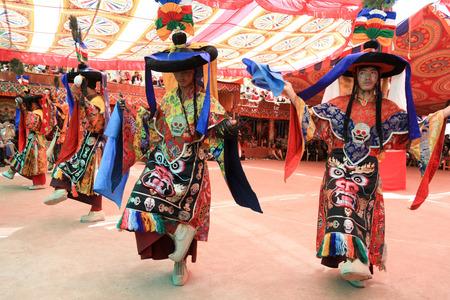 LADAKH, INDIA-JULY 29, 2012 - Unidentified buddhist monks dancing during a summer festival at Dak Thok Monastery in Ladakh, India Editoriali