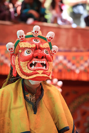 LADAKH, INDIA-JULY 29, 2012 - An unidentified buddhist monk dancing during a mask festival at Dak Thok Monastery in Ladakh, India