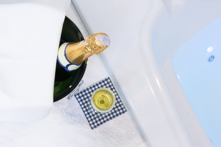 Champagne glass and whirlpool Spa with colourful light whirlpool