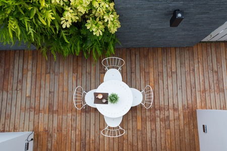 deck chairs: Vintage outdoor coffee table in cafe wooden terrace