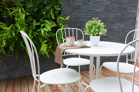 Vintage outdoor coffee table in cafe wooden terrace photo