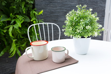Vintage outdoor coffee table in cafe wooden terrace
