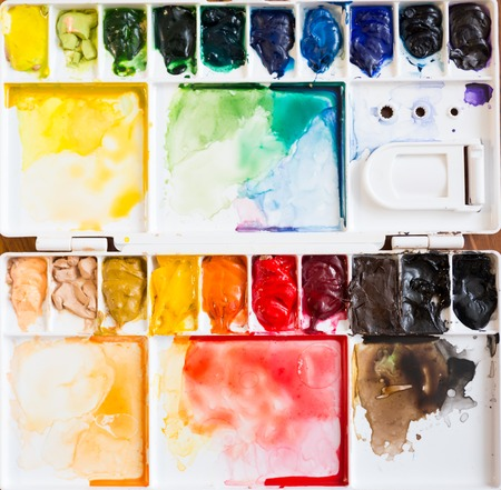 oil color: Paintbrush and paint palette with colorful mixed watercolor Stock Photo