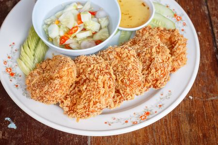 fresh food fish cake: Asian cuisine Fried shrimp cake served with sweet chili sauce Stock Photo